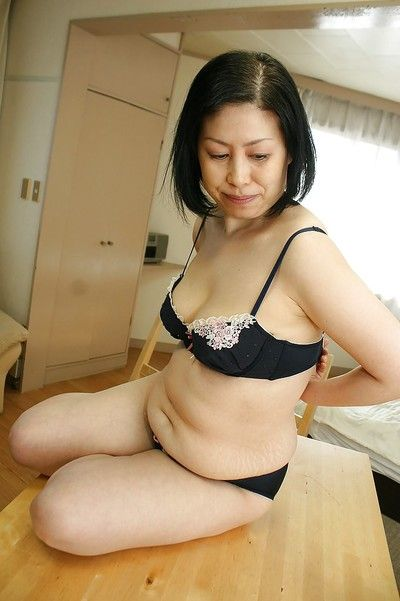 Fatty black-haired Asian milf Toyomi Furui slowly undresses!