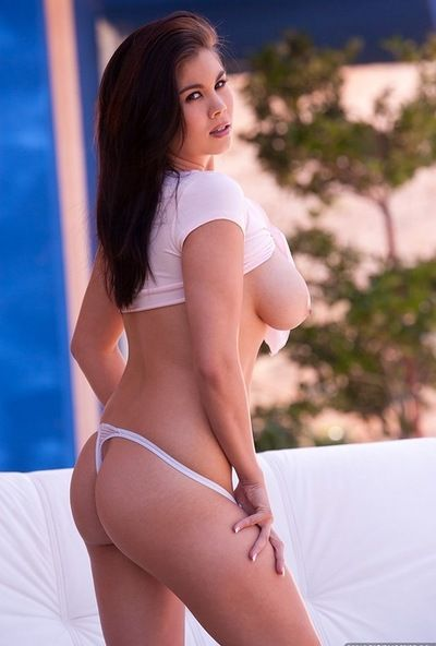Voluptuous Asian Mai Ly unties top and bares sexy big breasts outdoors