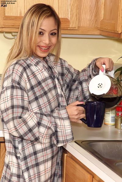 Flat chested filly Kat unwraps her petite smooth body in the kitchen and displays her holes