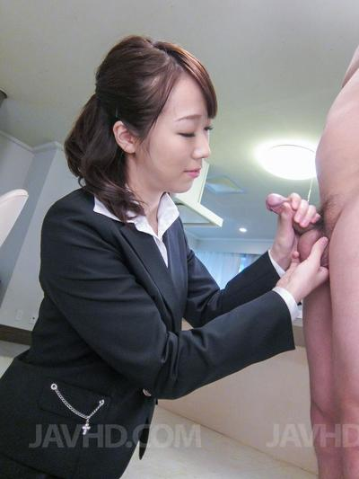 Naughty dark haired Asian secretary Hitomi Oki gives a hot blowjob and a ride