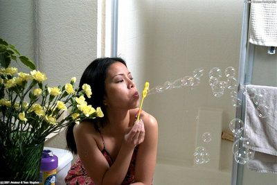 Amateur Asian woman Peggy blows soapy bubbles on her pussy