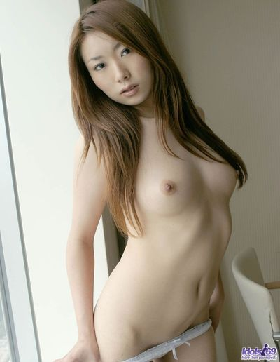 Skinny Asian chick Yuu Idols hotly posed nude and then pulled off her panties and showed hairy young cunt