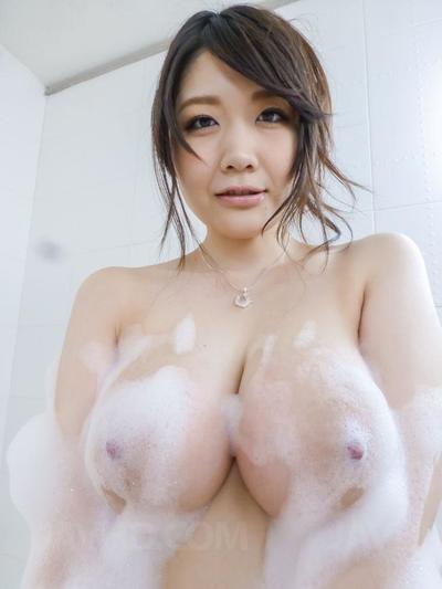 Smiling Asian bimbo Rie Tachikawa is slowly foaming and washing her big melons