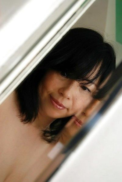 Asian MILF Norie Shibamura undressing and spreading her hairy lower lips