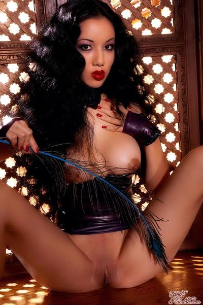 Glam asian Jade Vixen takes off her short tight latex dress and spreads her ultra long legs