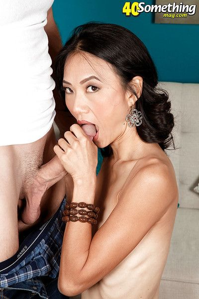 Mature asian Sahara Blue strips off underwear and rides a cock