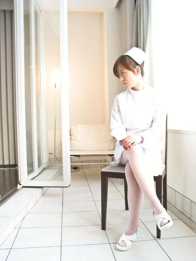Asian cutie Miina Minamoto wears a hot nurses uniform with sexy stockings and plays with herself