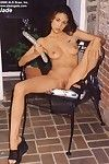 Lounging back in the chair Jade Hsu takes care of her horniness with long double headed dildo.