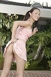 Lewd Asian bimbo Evelyn Lin found a nice place outdoor to demonstrate the shaved pussy