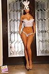Asian girl in lingerie and a mask dazzles with her smoking hot body