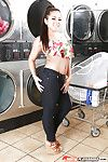 Asian pornstar Morgan Lee baring perky tits before masturbating at laundromat