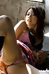 Hot ass asian teen Risa Kasumi exposing her gorgeous tits and trimmed pussy