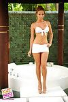 Little white bikini on a glamorous Asian girl posing outdoors