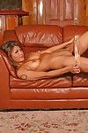 The enticing softcore session from Asian babe Charmane Star stripping on the leather sofa