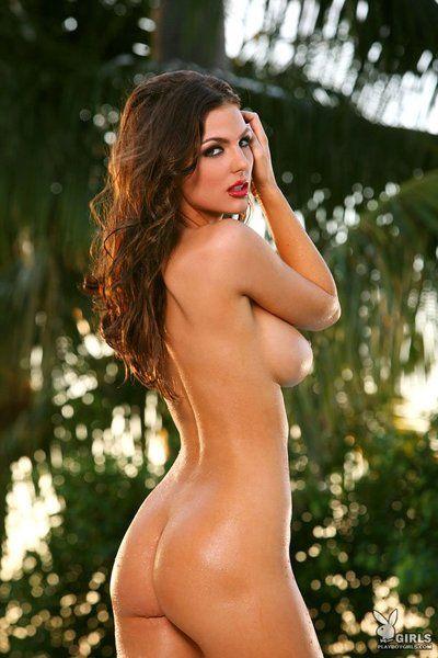 Bosomy brunette Jillian Beyor peels off her red swimming clothing beside the pool