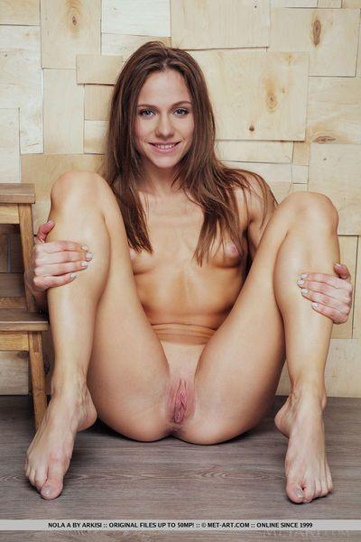 Slim cutie Nola A stretching legs for hot bald juvenile pussy close up