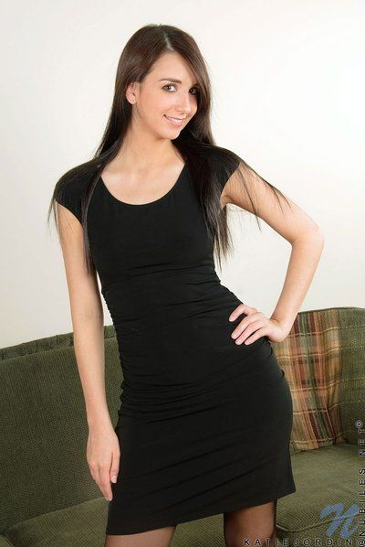 Brown hair queen Katie Jordin in stockings takes off her ebon dress and shows her pink snatch