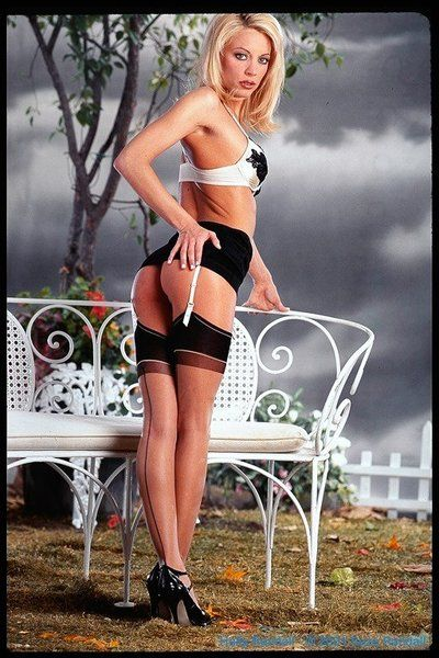Alluring blonde Holly Sampson in black underware and stockings plays on the bench