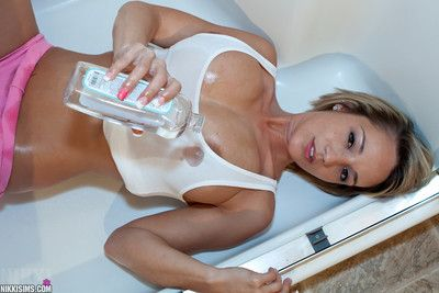 Teen fairy-haired Nikki Sims purchases oiled utterly dressed in the shower