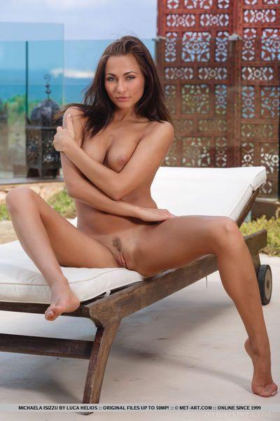 Leggy Euro girl Michaela Isizzu flashes no panty upskirt ahead of posing bare