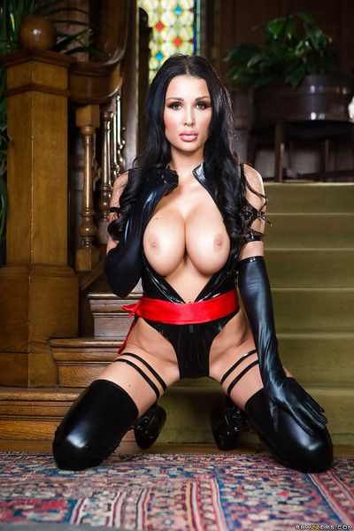 Dark brown babe Patty Michova freeing big pornstar bazookas from latex outfit