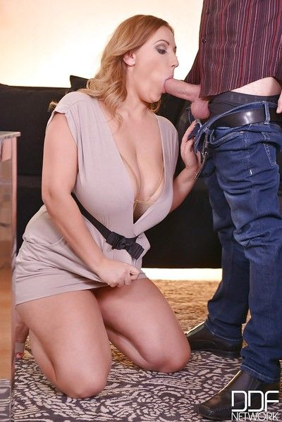 Chubby redhead Krystal Swift giving a blowjob on her knees