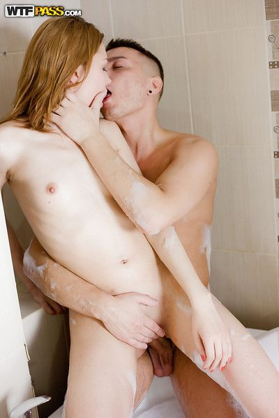 Redheaded adolescent honey Ksena Chais taking spunk fountain on diminutive breasts in shower