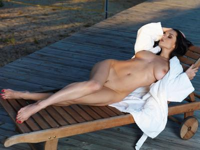 Fabulous brown hair babe Katie Fey is lying in the chaise require and exposing nude body