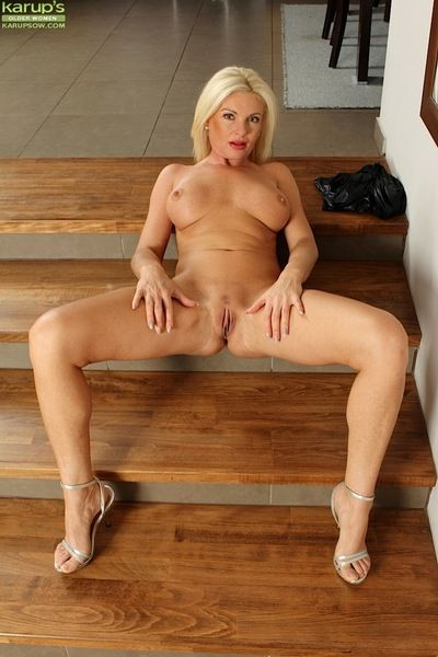 Fairy MILF Casey Szilvia unveiling large mambos and pussy in high heels