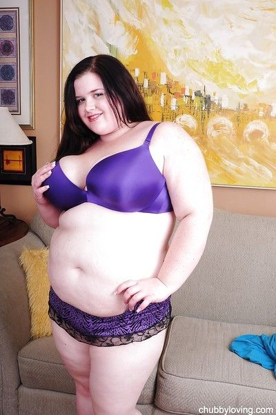 Dark brown fatty Linda teases her standard big breasts and shaved bawdy cleft