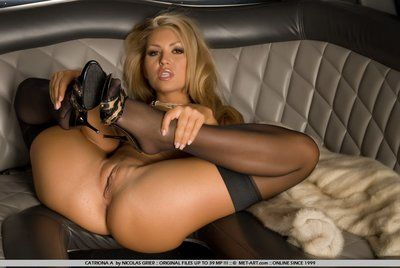 Sassy fairy-haired in black stockings Anette Dawn way and plays in a incredibly car