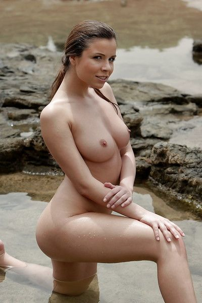 Beautiful pornstar gal demonstrates nice wazoo and bawdy cleft on the beach