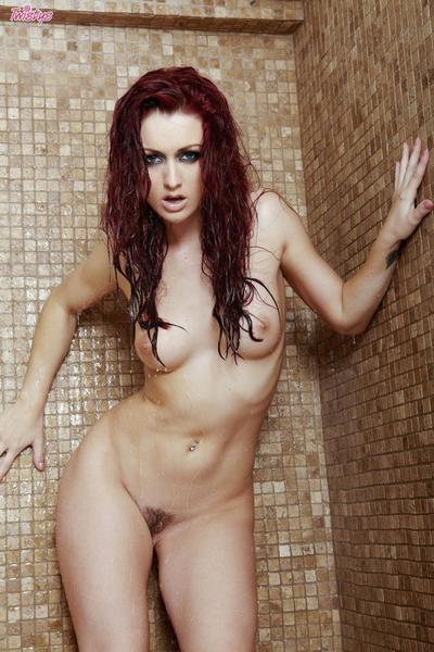Moist beauty Karlie Montana demonstrates her trimmed muff below the shower-room