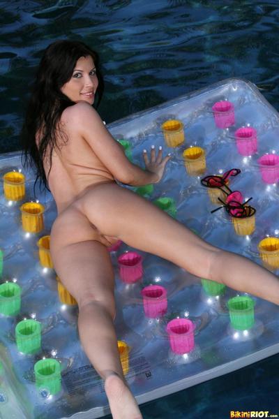 Black haired hispanic babe Rebecca Linares in bikini shows off her big marangos and clean pussy