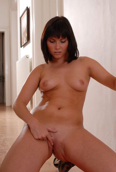 This lonely and admirable dark hair youthful in red underclothes is demonstrating her shaved twat