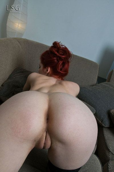 Redhead gal Piper Fawn in black nylons discloses her nicely shaped whoppers and snatch