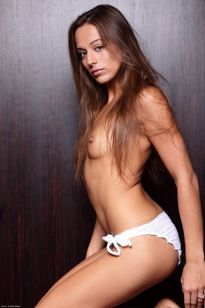 Skinny Dominika C with petite stuff nipples and tight shaved muff shows it all