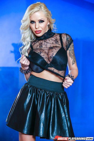 Tattooed Euro babe sheds short skirt before baring big MILF pornstar juggs