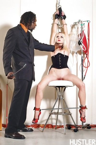 Inked blonde pornstar Faye dug by big ebon schlong during the time that shackled