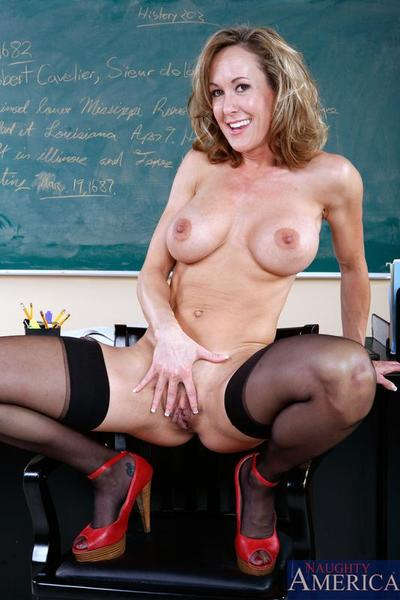 Biggest titted mature mentor Brandi Love in red shoes and brown stockings rides stick