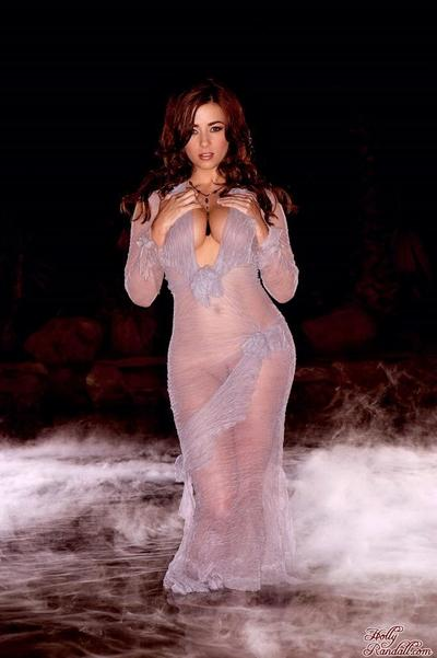 Giant titted brunette hair Taylor Vixen in transparent dress shows it all in smoke-filled shady room