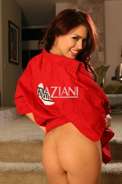 Smiling porn diva Eva Angelina in red coat shows her big jugs and trimmed pussy