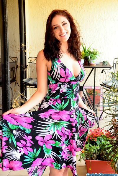 Impressive and good looking babe Carlotta Champagne in dress is showing her amazing lumps