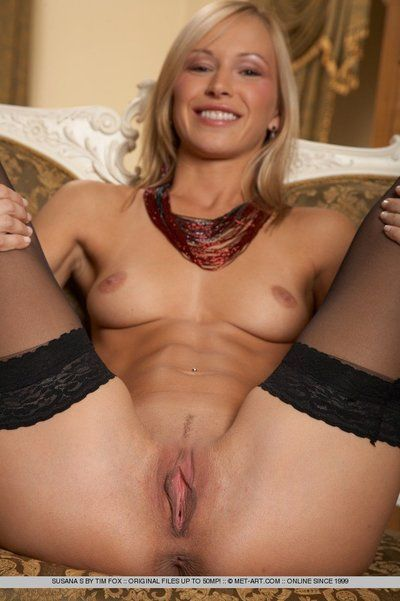 Skinny blonde Susana Spears in black stockings shows off her nicely shaved snatch