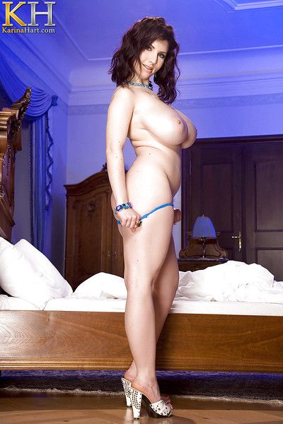 Busty brunette solo girl Karina Hart ditches bra and panties in high heels