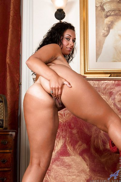 Chubby European brunette Anastasia Lux exposing big MILF tits and ass