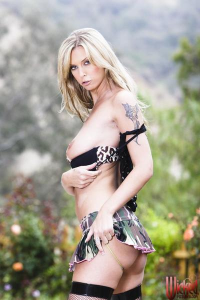 The nasty blonde babe in sheer stockings Brooke Banner is showing tits outdoor