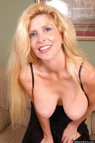 Older blonde lady Sugar baring huge saggy boobs while disrobing
