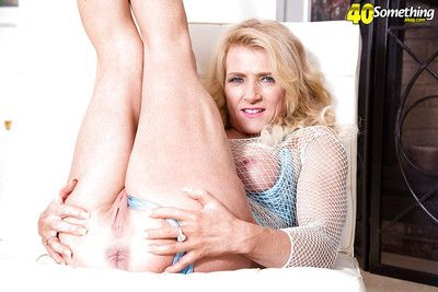 Blonde babe Amanda Verhooks frees over 40 MILF tits from mesh top