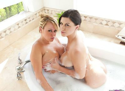 Nasty and admirable lesbians with big tatas are playing with each other in the bathtub